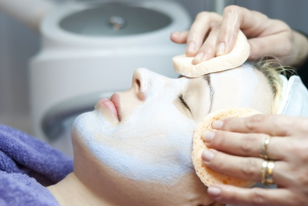 tratment: Beautiful young woman lies on a table in a beauty spa getting a treatment  Stock Photo