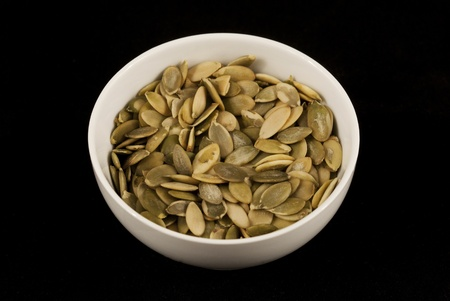 Close up of bowl full of pumpkin seeds