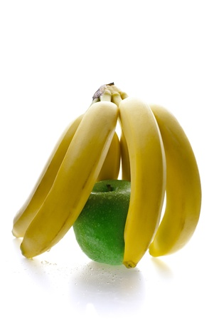 Close up of green apple behind the banana bars Stock Photo