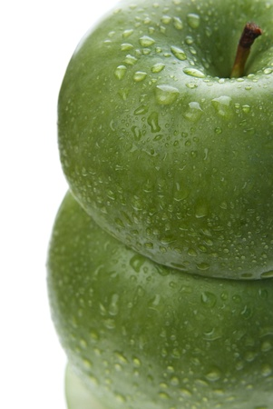 Close up from above of tower made of two green apples isolated on white
