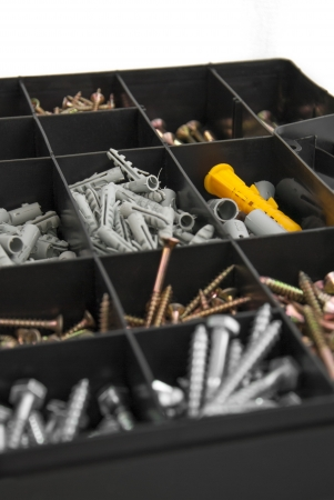 Plastik: Close up of black plastik box with screws and dowels Stock Photo
