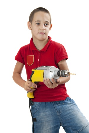 Cute boy posing with drill in his hands, isolated on white Stock Photo