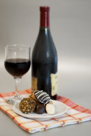 Wine and homemade cookies served on tea cloth photo