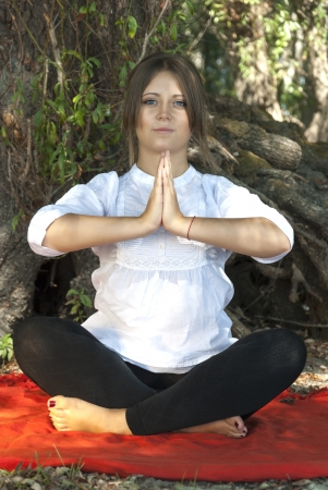 Beutiful young girl meditating in nature Stock Photo
