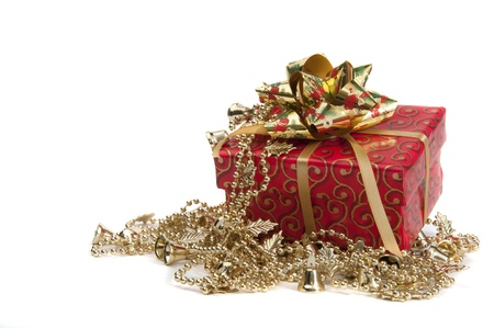Giftbox wripped in red paper with golden bow isolated on white Stock Photo