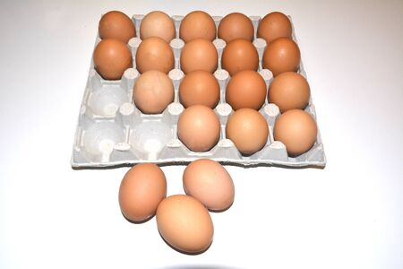 20 chicken eggs per pack. There is a place for inscription, with the image of eggs on the right side. Three eggs are laid out and lie next to a white background. Empty cells in the package