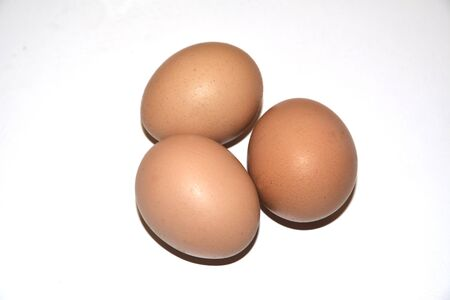 Three brown chicken eggs lie on an abelone background. Idea for breakfast. Ingredients for cooking Stockfoto