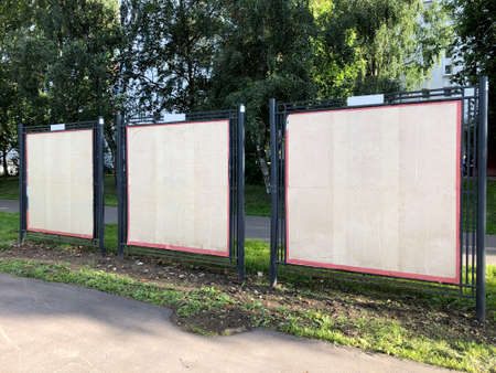 Blank billboards in the city. Due to the pandemic, concerts and performances were canceled. Two empty billboards on the street Stockfoto