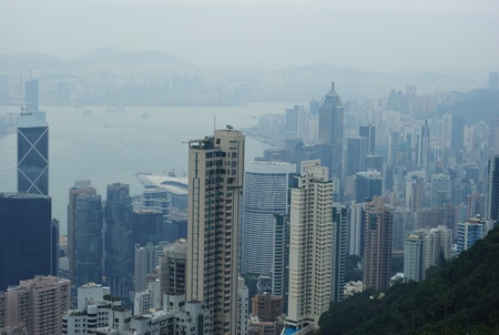 The Panorama of the Victoria Harbour of Hong Kong from the Peak photo