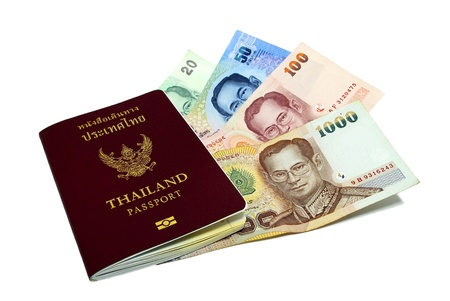 customs official: Thailand passport and Thai money on white background