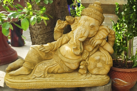 Golden statue of Ganesha - the Elephant headed god of luck and prosperity photo