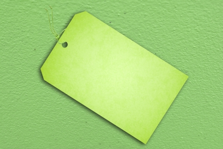 Sale Tag On Green wall texture for background usage photo