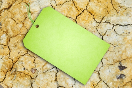 Sale Tag on Dry soil texture Stock Photo - 15158303