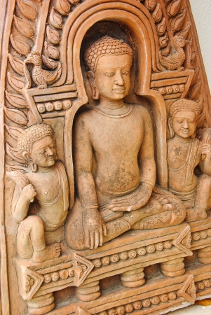buddha statue on wall photo