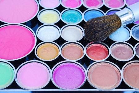Makeup brushes and make-up eye shadows photo