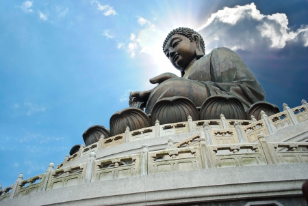 Giant Buddha sitting on lotusl  Hong Kong photo