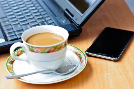a cup of coffee and a laptop Stock Photo - 15794218