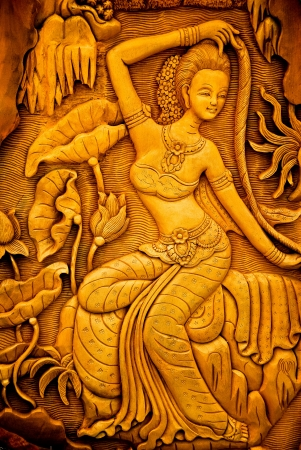 Carved woman on the wall. Thailand. Stock Photo