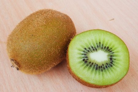Fresh kiwis on wooden ground photo