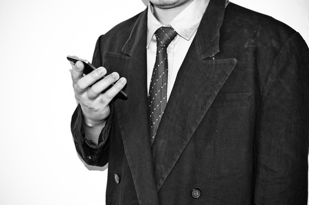 Business man working with phone on white background photo