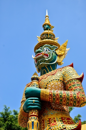 Demon statue on Grand Palace or Temple of the Emerald Buddha photo