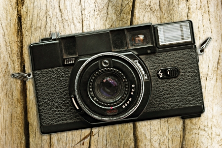 Vintage photo camera on a wooden table photo