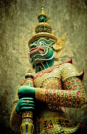 Ancient giant sculpture of The Emerald Buddha temple in Bangkok, Thailand photo