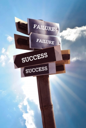 bidirectional: two road signs with words success and failure Stock Photo