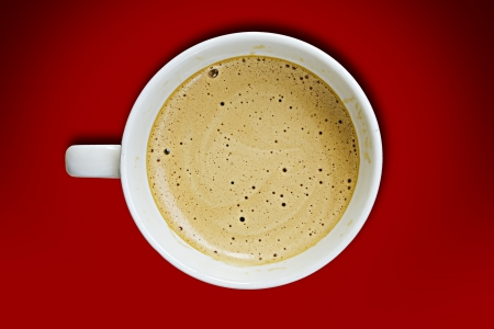 Coffee cup on a red  background. photo