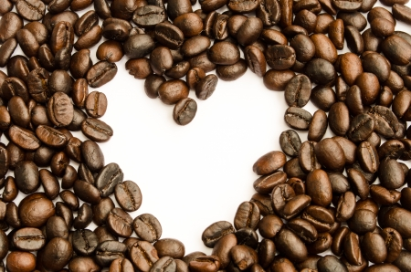 Coffee beans heart on white background photo
