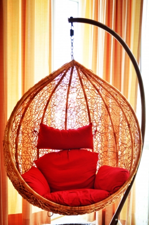 Hanging rattan chair in modern room photo