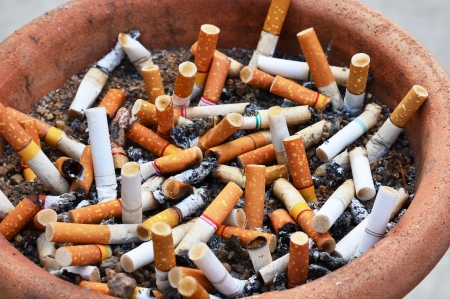 Cigarettes in ashtray photo