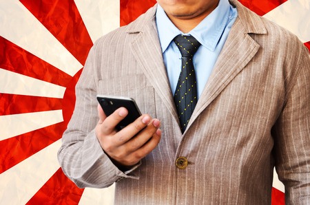 Business man working with phone on  on Japanese navy flag  background photo