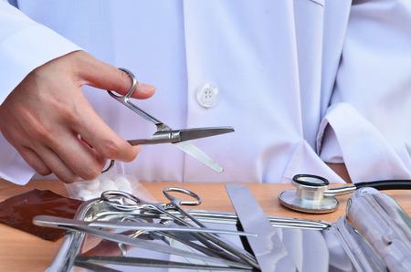 Doctor with scissors photo