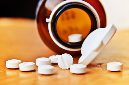 Pills Spilling out of Pill Bottle Stock Photo