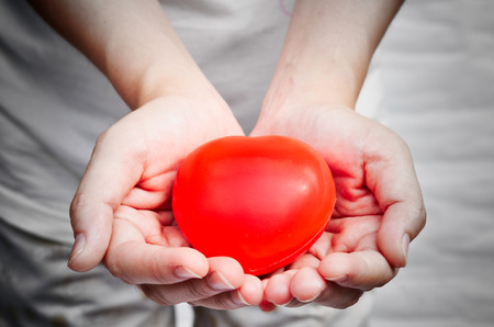 Heart on hands photo