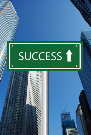 Success road sign on corporate building background photo