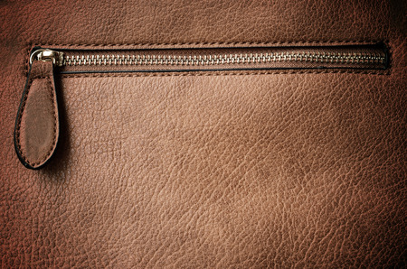 Leather background with zipper photo