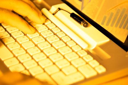 Typing on keyboard photo