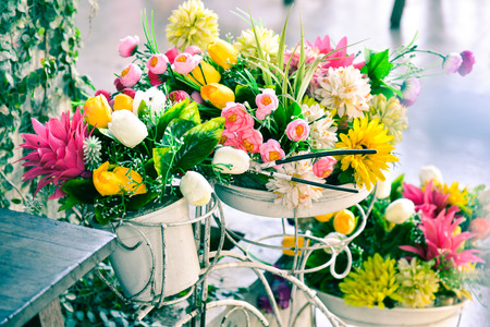 artificial flowers: Decoration artificial flower in basket on bicycle