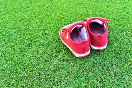 15 18: Little red shoes on grass
