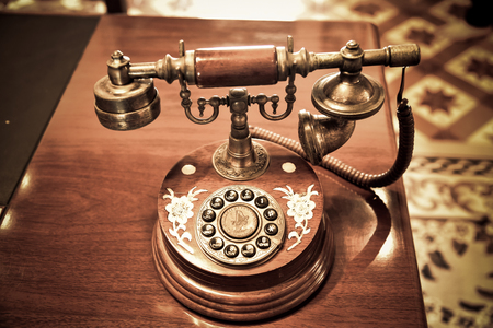 Vintage telephone on old table Stock Photo