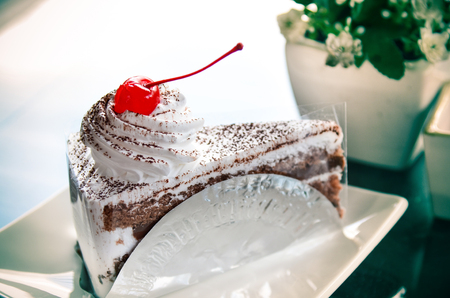 Yummy chocolate cake with cherry