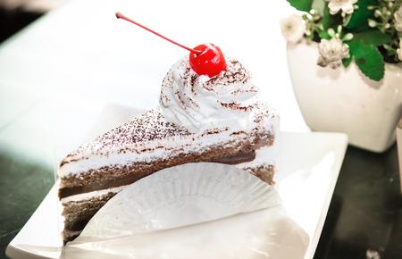 Yummy chocolate cake with cherry