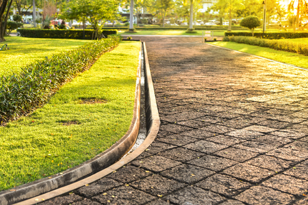 Sunset In park walkway Stock Photo