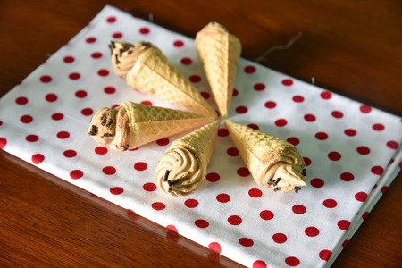 Mini coffee conical ice cream in white and red handkerchief