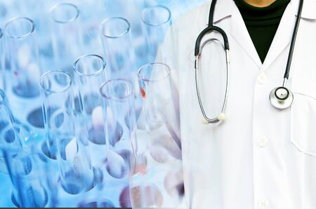 Doctor with stethoscope on Lab science research glass items several test tubes background. Medical research in laboratory Banco de Imagens