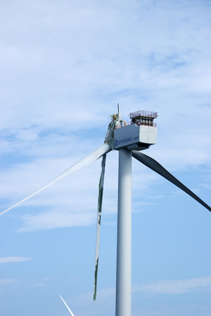 A wind turbine with torn wings on a tappu