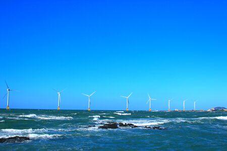 scenery of wind power generator on the coast of Jeju.