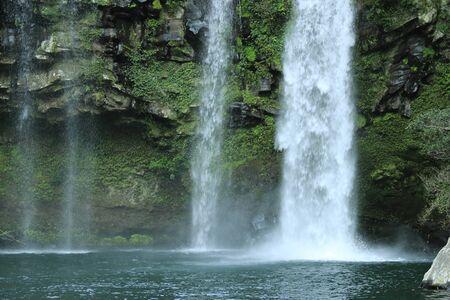 It is a winter scene of Cheonjiyeon waterfall in Jeju.